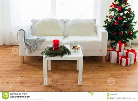 sofa table and tree with gifts at home stock