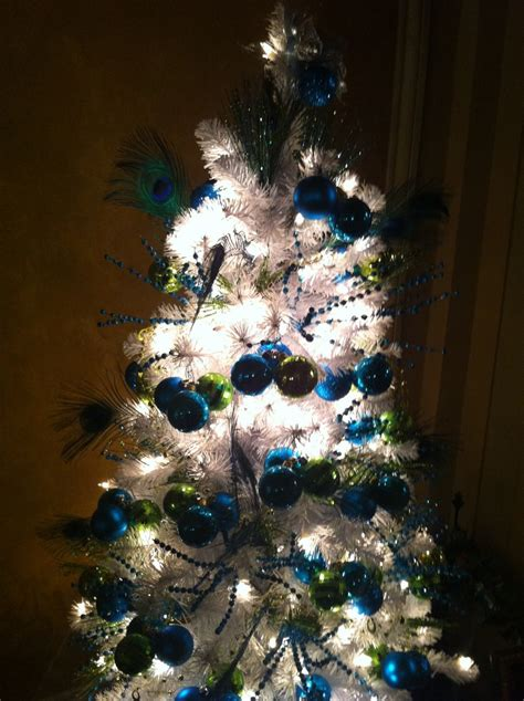 white christmas tree with peacock colors