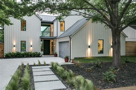 modern farmhouse exterior lighting like white light board and batten black windows and grey