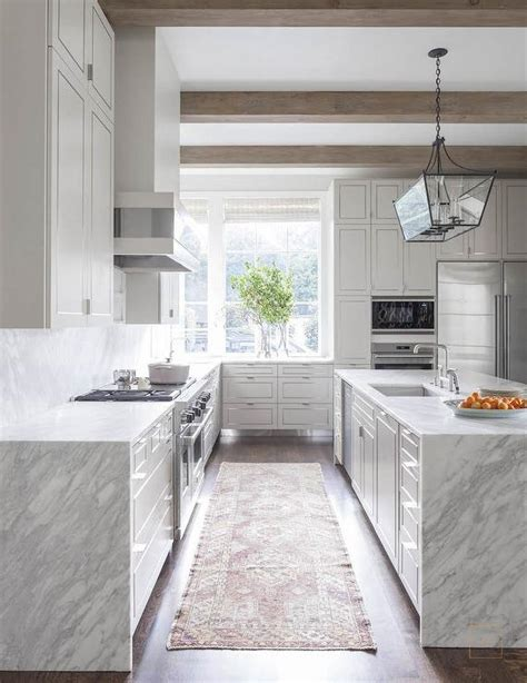White Kitchen With Grey And White Quartzite Waterfall Edge White Kitchen Cabinets With Grey Countertops
