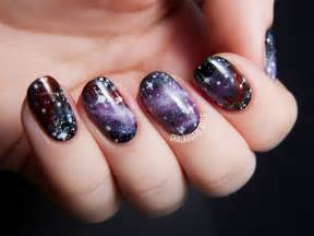 purple galaxy nails inspired by the pelican nebula
