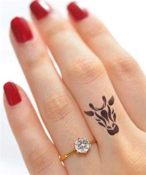 pretty tiny finger tattoo design dinga poonga