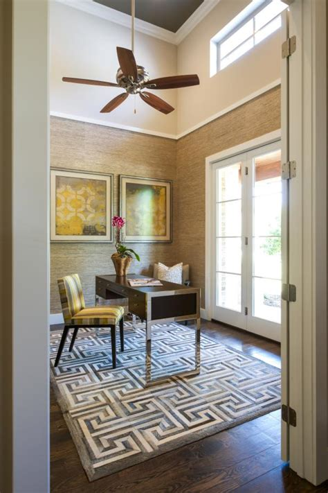 contemporary home office features greek key area rug