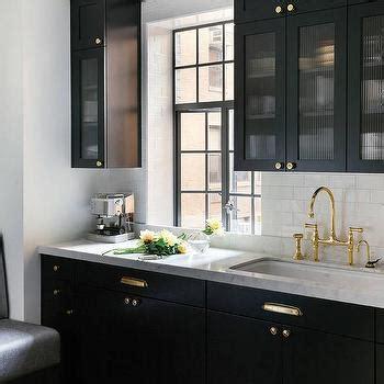 white kitchen ccabinets  brass pulls cottage kitchen