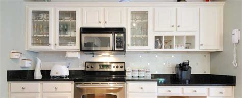 how to price painting cabinets compare 2018 average painting vs staining cabinets costs