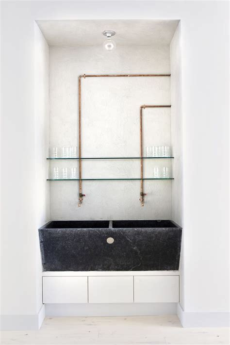 Exposed Plumbing Sink by Sink In A Modern Setting With Exposed Copper