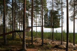 le forest invisible tree hotel is camouflaged in lush swedish forest
