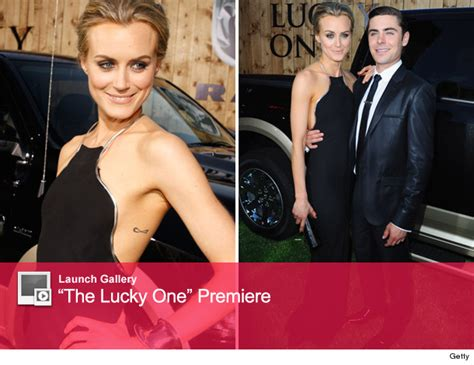 taylor schilling tattoo quot the lucky one quot flaunts figure on carpet