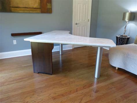 hand  rhino marble desk  craig taylor design