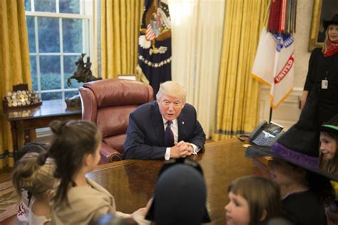 trump hosts white house reporters kids for oval office trump greets reporters kids for halloween treats