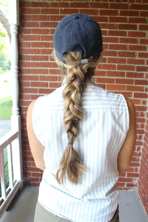 wear a hat with braids baseball hat hairstyles the dress decoded