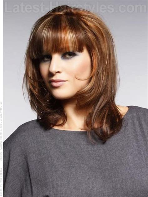 medium haircuts and how to cut strictly bangs highlighted medium cut with long bangs