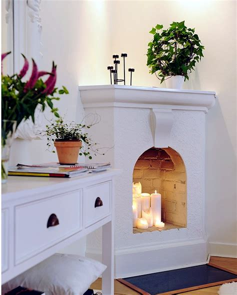Fireplace Decorating Ideas decorate the unused fireplace in the living room 20