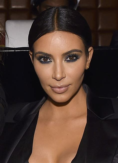 kim kardashians low sleek ponytail with center part celebrity kim kardashian hair transformation