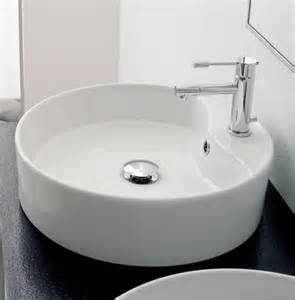beautiful white ceramic vessel sink by scarabeo