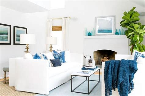 blue and white sofa white coastal living room with blue accents cottage