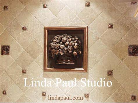 fruit basket metal and mosaic tile medallion kitchen backsplash