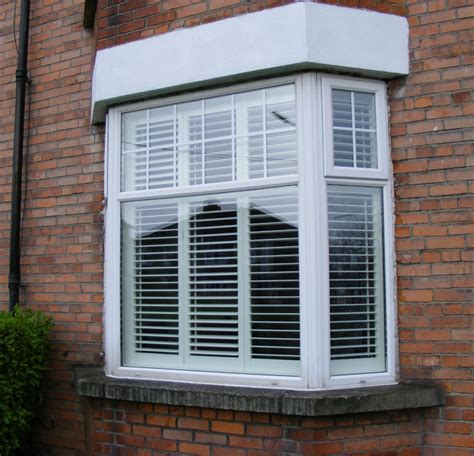 Window Treatments Bow Windows exterior view of bay window shutters