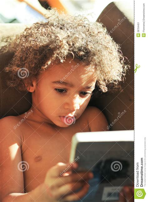 skull cut baby curls for black hair young mixed race boy with curly hair reading stock image