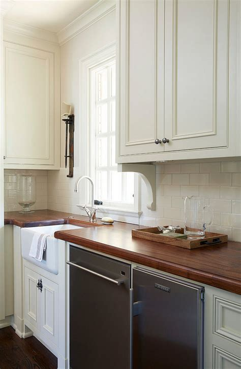 white cabinets white countertop traditional white kitchen with brick backsplash home