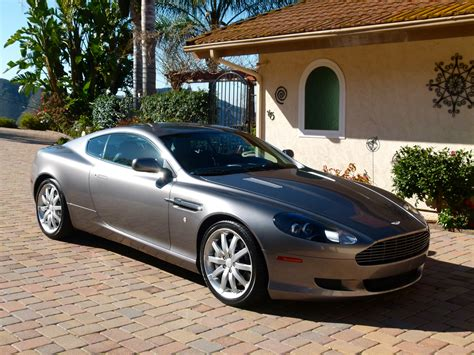 photos and videos 2005 aston martin db9 coupe history in pictures kelley blue book 2005 aston martin db9 pictures cargurus