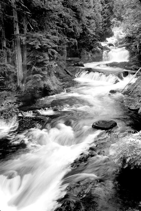Downstream Waterfall on Black Rocks during Day · Free