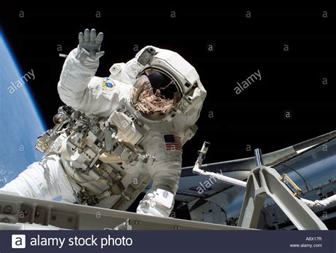 reset walka online astronaut joseph r tanner waves toward the camera during a
