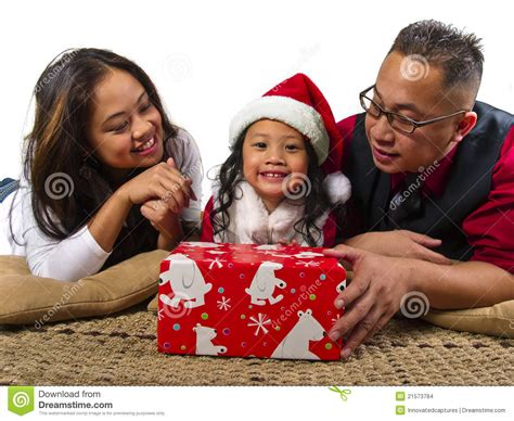 what to give to parents for christmas parents giving the child a gift stock photo image 21573784