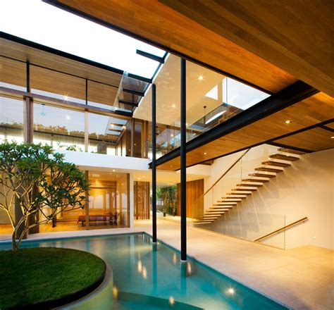 seafront home in singapore with underwater media room pool glass wood stairs stunning beachfront home with