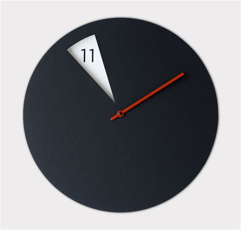 design wall clock sabrina fossi s minimally designed freakish wall clock