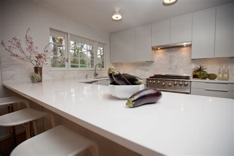 white quartz countertops set on wooden kitchen furniture