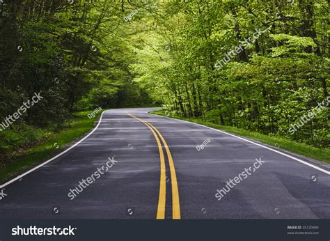 curved road with trees on both sides stock photo colourbox road with trees on both sides stock photo 35120494