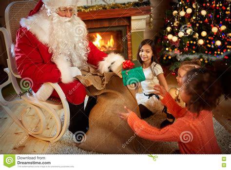 santa claus gives presents stock photo image 79254936