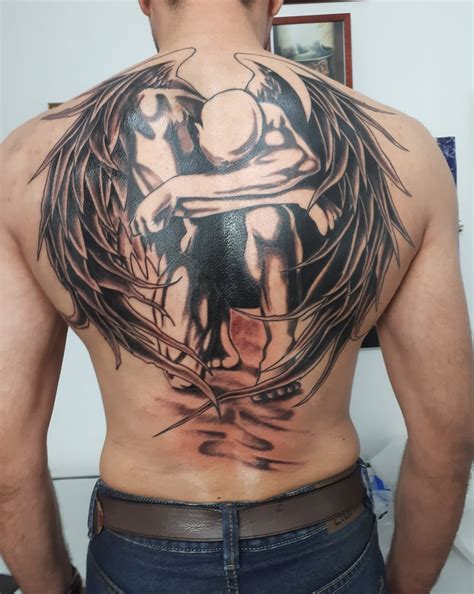 fallen angel tribal tattoo images designs