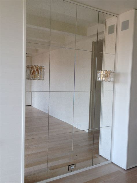 wall to wall mirror install wall mirrors without damaging your apartment walls
