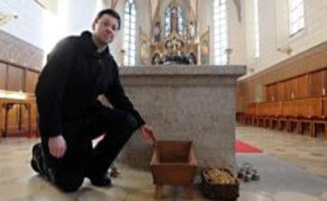 village gossip meaning german priest finds newborn baby left in church nativity scene