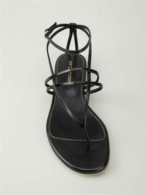 black flat strappy shoes sergio strappy flat sandals in black lyst