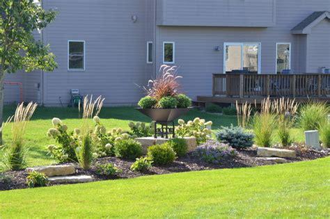 backyard berm backyard berm with outcrop stones and planter