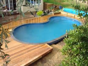 Backyard Retreats Pools And Spas Above Ground Swimming Pool Designs Pools And Spas Pool