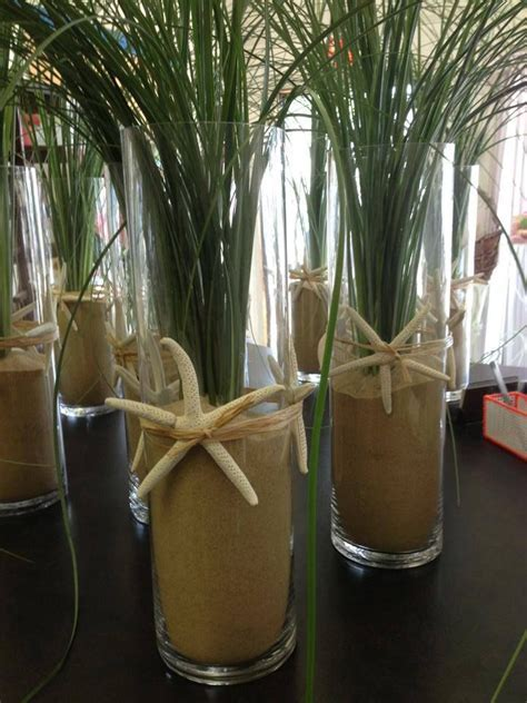 Bear Grass Centerpiece in tall cylinder accented with