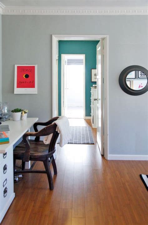 the living room color is half moon crest from benjamin and the hallway color is lost