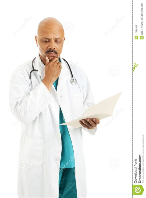 doctor reviews patient chart royalty  stock images image