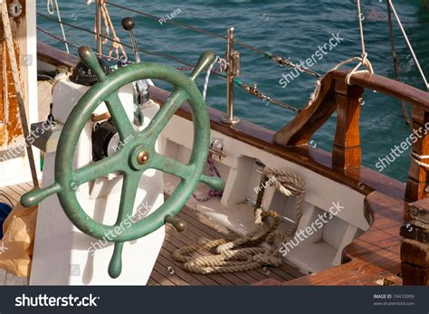 small fishing boats with steering wheel green steering wheel of small old greek fishing boat