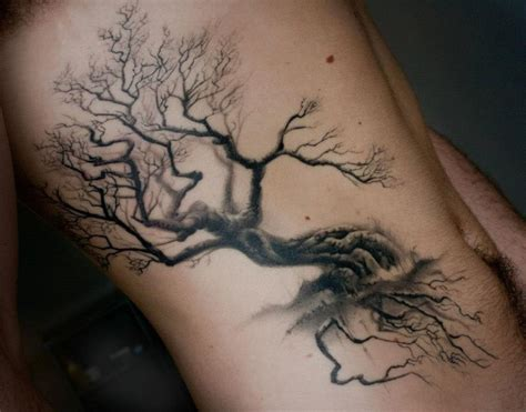elegant black tree tattoo on ribs tattoos book 65 000