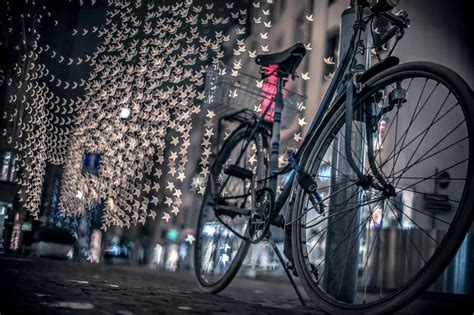 christmas  happy  year  bicycle parked  pavement  evening city lights wallpaper