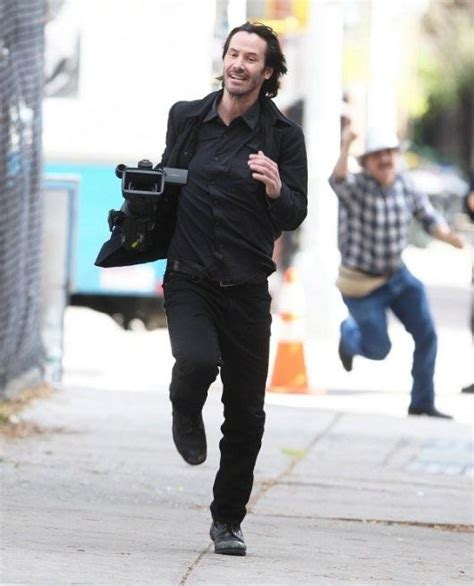 Keanu In With Paparazzo keanu reeves stealing a from the paparazzi