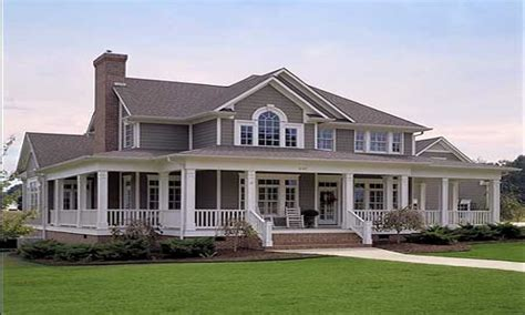 farmhouse with wrap around porch cabin style mansion modern house