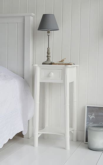 narrow tall white bedside table  drawer  chunky knob handle  white lighthouse