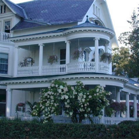 porches wrap around porches and victorian on pinterest ooooooooh gorgeous victorian house with double wraparound