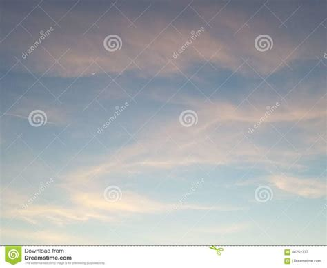 pink clouds sunset with moon crest4k stock photo